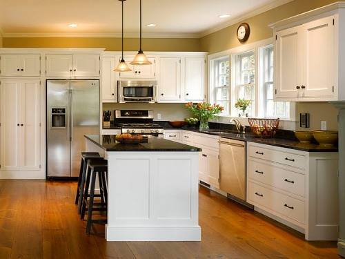 Kitchen With White Cabinets Dark Counters The Interior